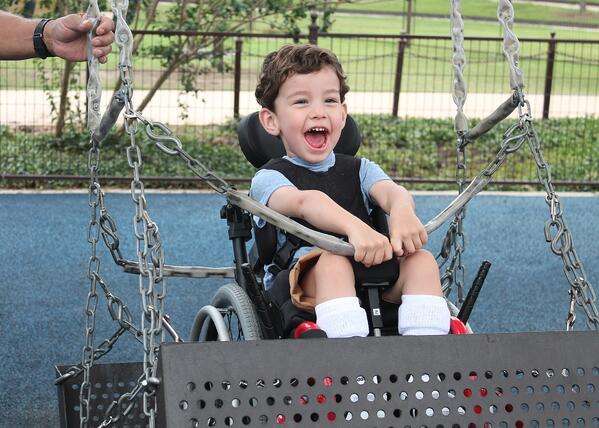 APA - Child Swinging at All Abilities Park