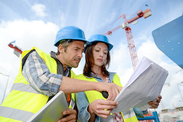 Construction manager and engineer working on building site-1