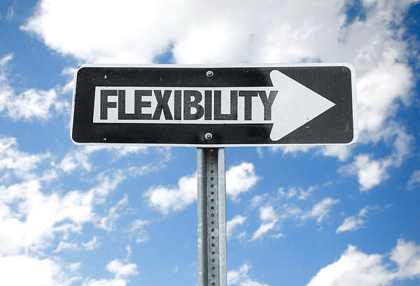 Flexibility direction sign with sky background