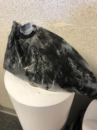 Over-Full-waste-toner-bag-TAVCO