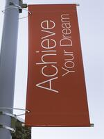 Motivational banner on campus of community college Achieve Your Dream